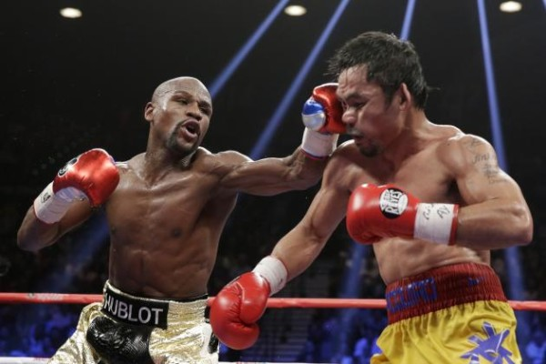 In this pitcure, Pacquiao represents the state of journalism. Seen here being punched by Money